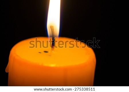Light of candles on back background. - stock photo