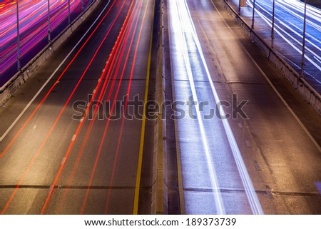 Light of car headlights At night with cars on the streets at night. - stock photo