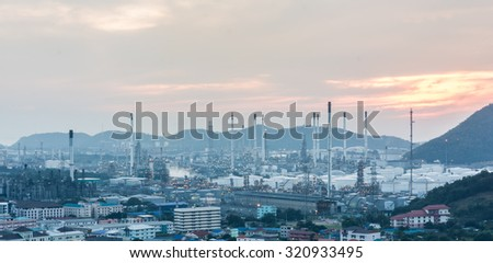 Light of petrochemical industry power station on sunset of Thailand - stock photo