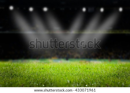 light of stadium or football Stadium, at time Stadium night, stadium light and night stadium lights grass background. - stock photo