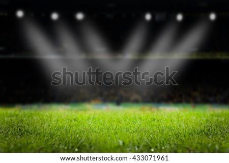 light of stadium or football Stadium, at time Stadium night, stadium light and night stadium lights grass background. - stock photo