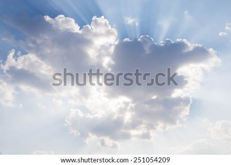 Light of the sun through the sky blue with clouds - stock photo
