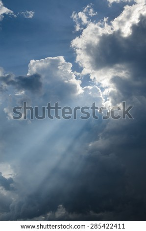 Light of the sun through the sky with clouds. - stock photo
