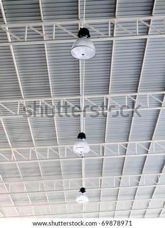Light on roof of modern storehouse - stock photo
