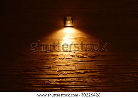 light on the colored wall texture - stock photo