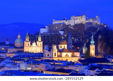 Light on the facades of old churches and castle in Salzburg old town, Austria - stock photo