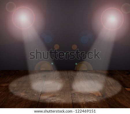 Light on wooden floor in empty room