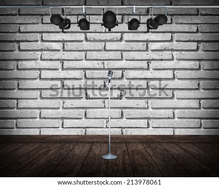 Light on wooden floor in empty stage with microphone and spotlight  - stock photo