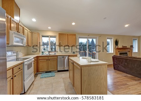 Light Open Concept Kitchen Room With Vaulted Ceiling, Tile Floor, Fitted  With Maple Cabinets
