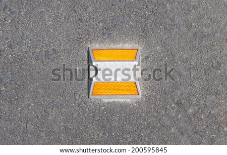 Light pin on the road. - stock photo