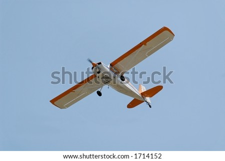 Light plane flying overhead, Palo Alto Airport, California