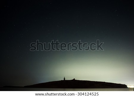 Light pollution silhouettes St. Paul's Islands in Malta. - stock photo
