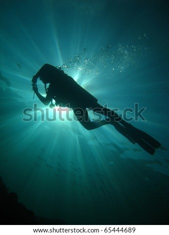 Light Power with a diver - stock photo