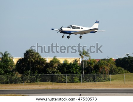 Light private airplane moments before landing - stock photo