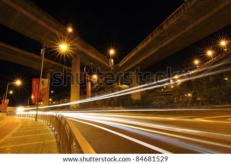 Light rail on the overpass at night