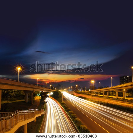 Light rail on the overpass at night - stock photo