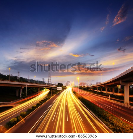 Light rail on the overpass at night - stock photo
