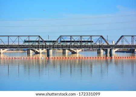 Light Rail Train Crossing the Bridge over Tempe Town Lake  - stock photo