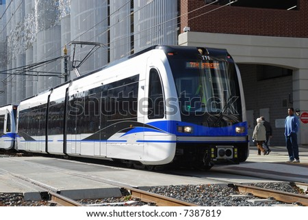 light rail train system in downtown charlotte nc - stock photo