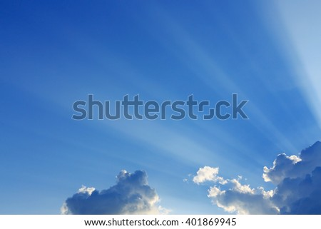 light rays on clear blue sky background