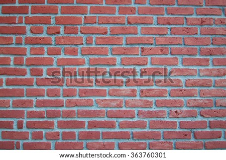 Light Red Brick with light grey grout on a wall