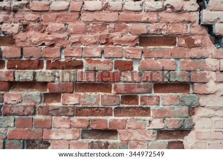 Light red damaged brick wall texture background.  - stock photo