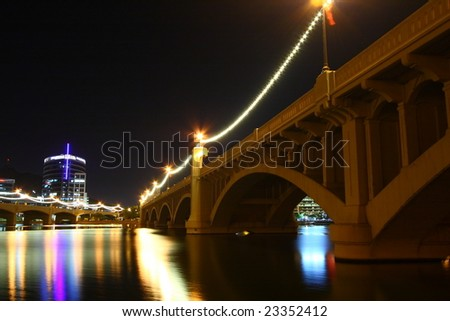 Light reflections on Tempe Arizona town lake bridge - stock photo