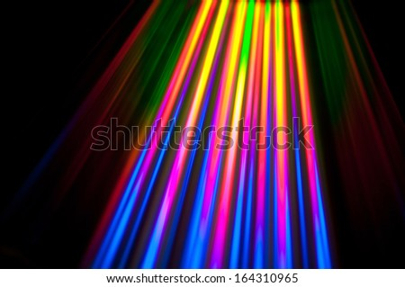 Light reflects from the surface of a cd. - stock photo