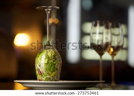 Light salad with a mix of herbs, eel, crab and pine nuts - stock photo