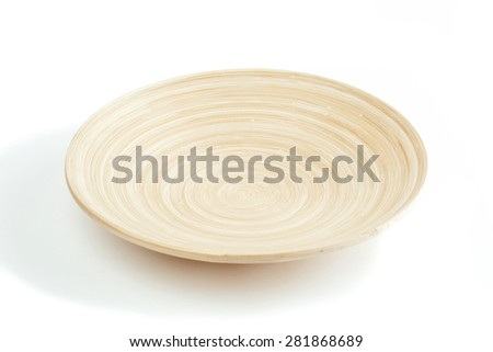 light saucer made of clay on white background - stock photo