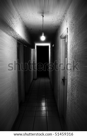 Light shining in dark basement corridor. Motion blur.