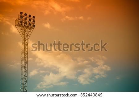 Light stadium or Sports lighting against blue sky - stock photo
