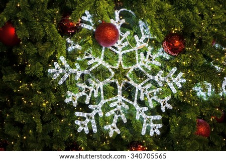 Light star decorated on christmas tree. - stock photo
