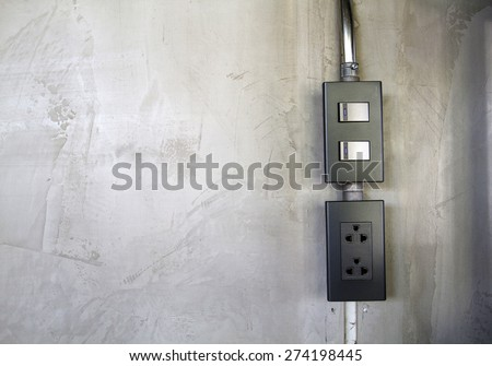 Light switch and Electric switch and plug  on the wall cement - stock photo