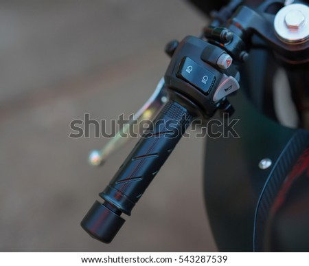 Light switch on a motorcycle handlebar
