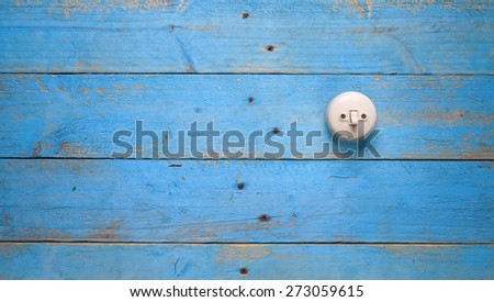light switch on blue wood wall, free copy space - stock photo