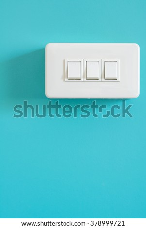 light switch on switchboard. green background - stock photo