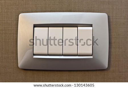 Light switch on the wall - stock photo