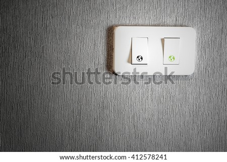 Light switch on wall; earth sign, energy saving concept - stock photo