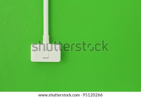 Light switches on the green wall - stock photo