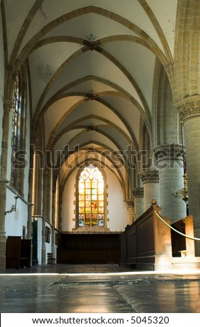 Light through a stained window inside the Bavo Protestant Church in Haarlem, the Netherlands - stock photo