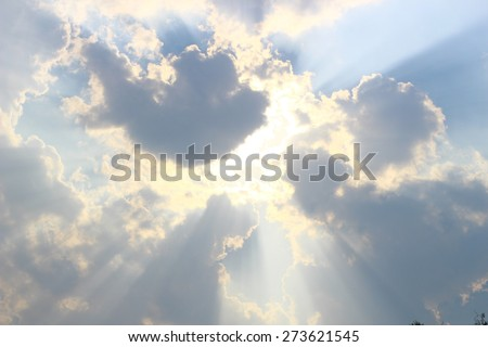 Light through clouds with blue sky  - stock photo