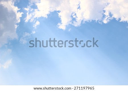 Light through clouds with blue sky background, spiritual image - stock photo