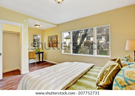 Light tones bedroom interior with small office area - stock photo