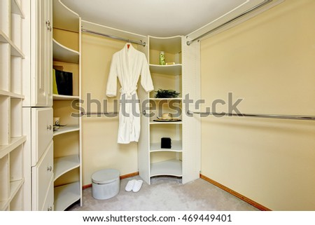 Light tones walk-in closet with shelves and carpet floor. Northwest, USA