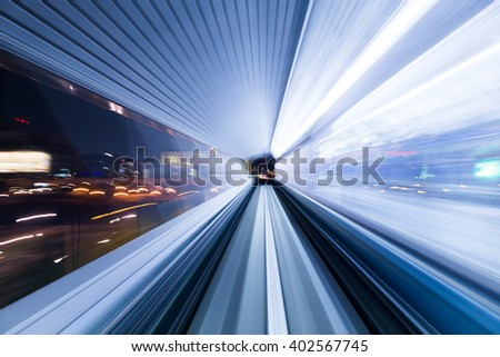 Light trail accelerating through a tunnel - stock photo