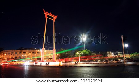 Light trail around Giant swing at night in Bangkok, Thailand