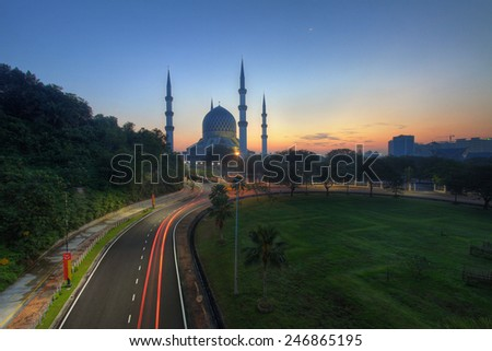 Light trail at busy highway with the view Shah Alam Mosque - stock photo