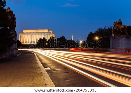 Light trail at Lincoln Memorial, seen from the Memorial bridge, Washington DC, USA. - stock photo