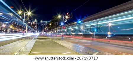 Light trail motion blur of traffic in the city at night - stock photo